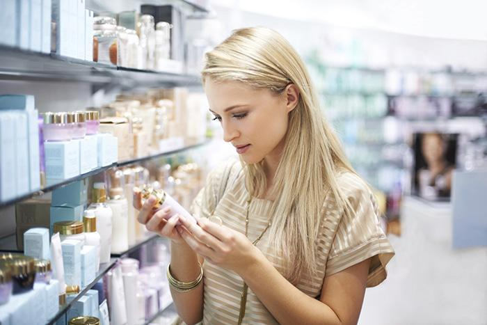 175460 700x467 Woman looking at skincare TS new 3 Things to Consider While Looking for a Skin Care Product